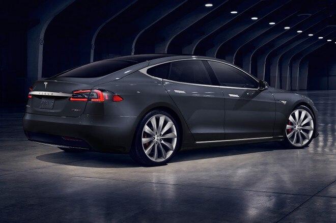 2017 Tesla Model S rear three quarter view lights on