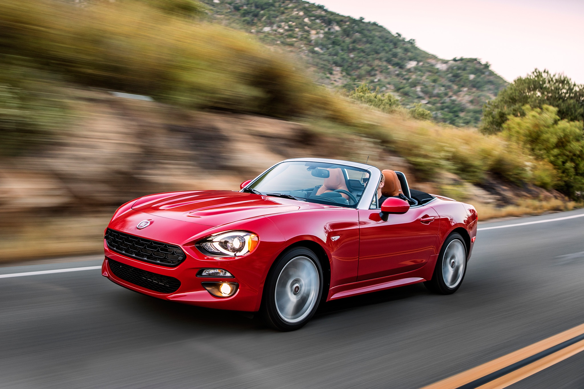 2017 Fiat 124 Spider Lusso Front Three Quarter In Motion 01