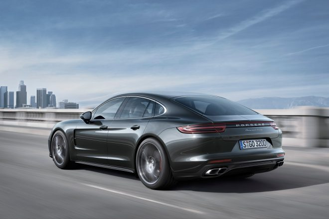 2017 Porsche Panamera Turbo rear three quarter in motion 01