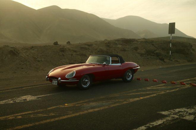 1964 Jaguar E Type Roadster Petrolicious front three quarters far