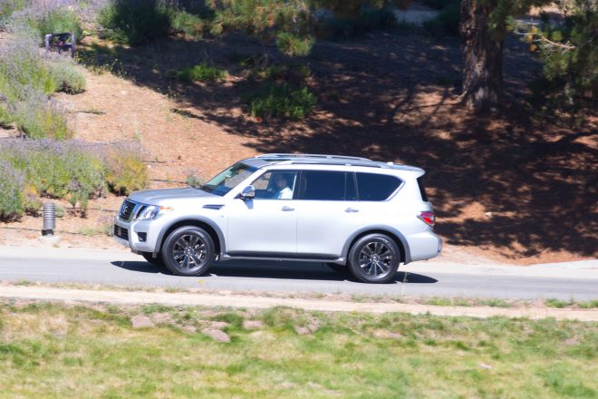2017 Nissan Armada side profile in motion 01