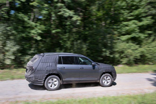 Volkswagen Midsize SUV Prototype side profile in motion 02