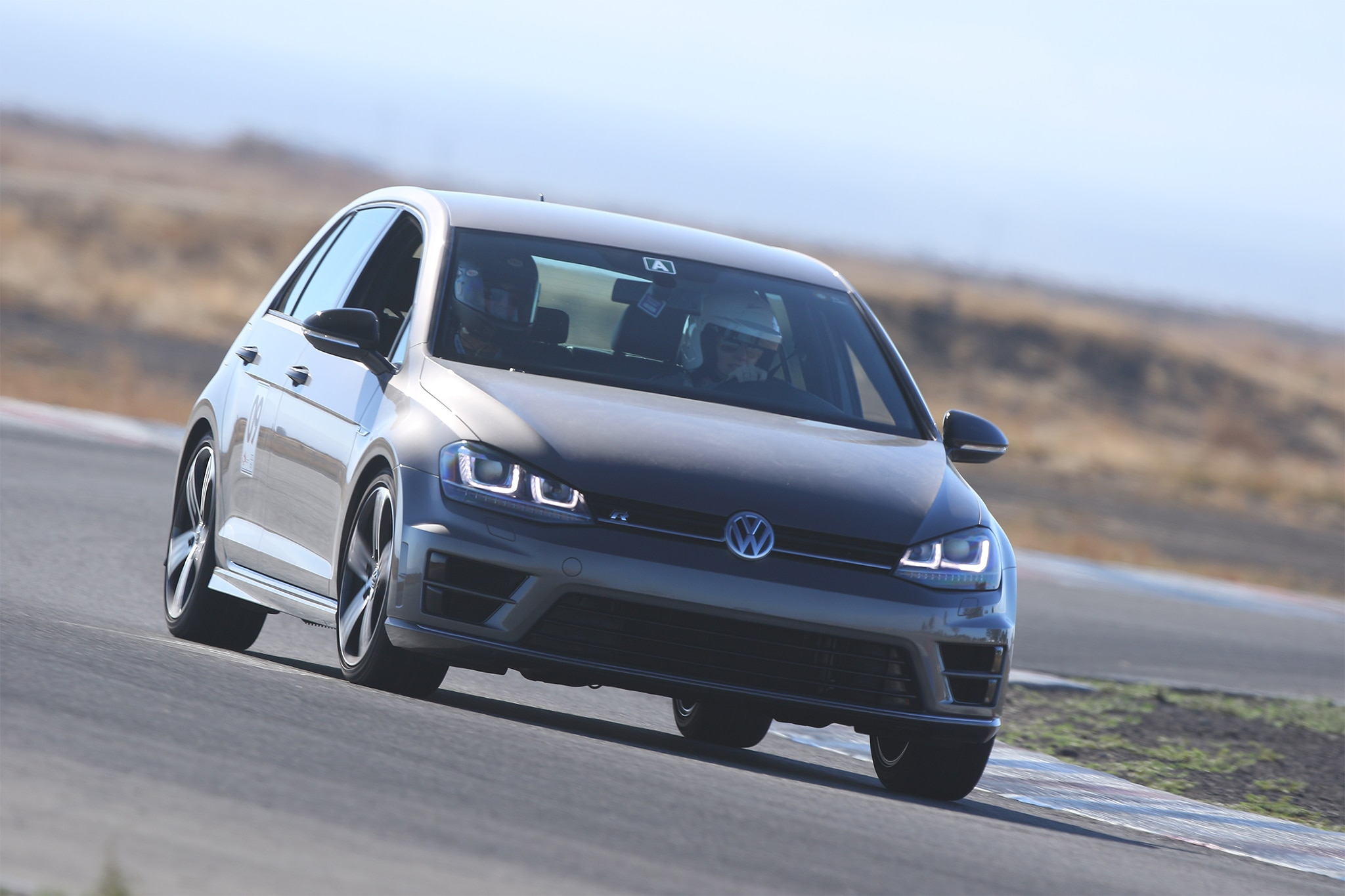 2016 Volkswagen Golf R Front Three Quarter In Motion 02