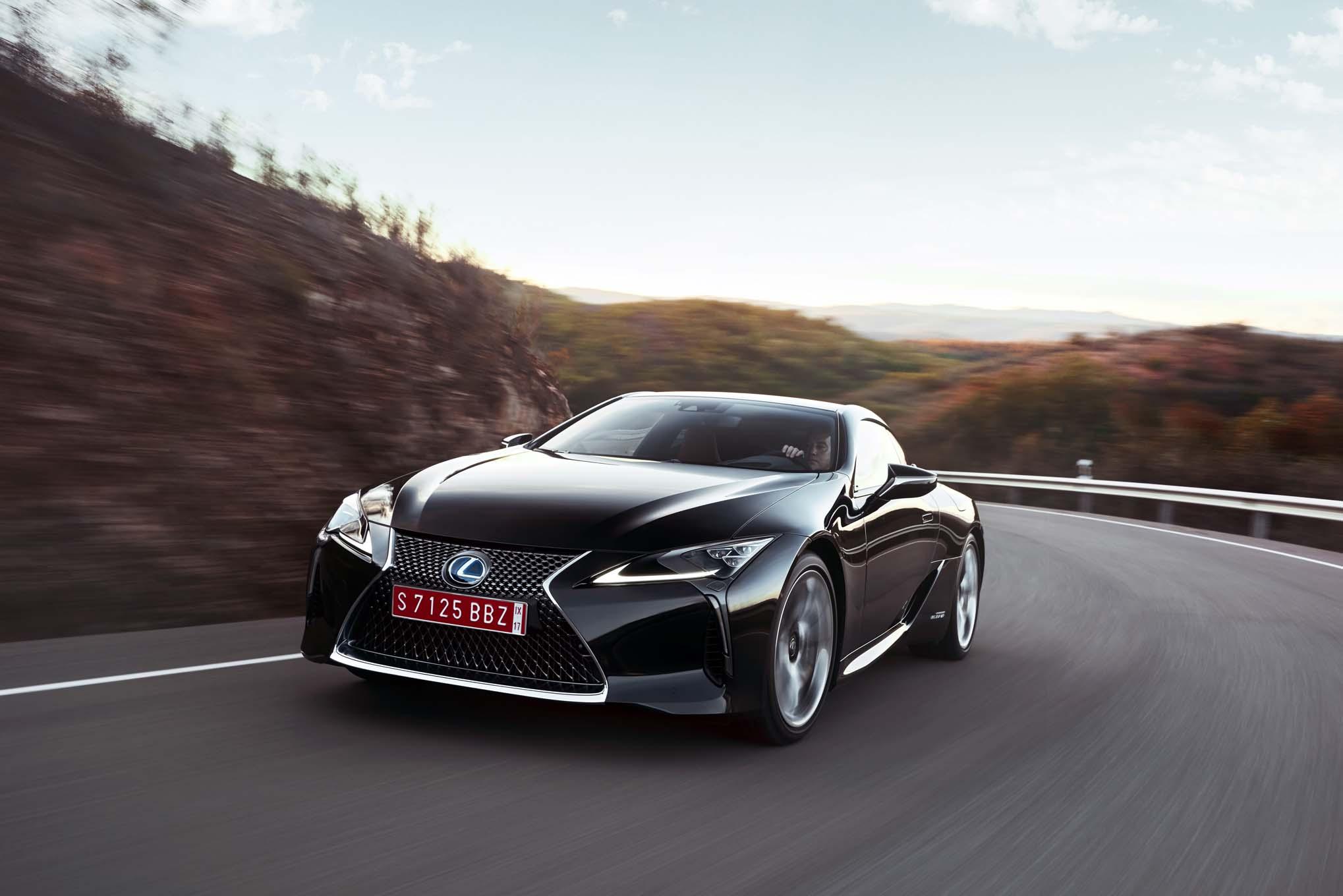 https://st.automobilemag.com/uploads/sites/11/2016/12/2018-Lexus-LC-500h-front-three-quarter-in-motion-09.jpg