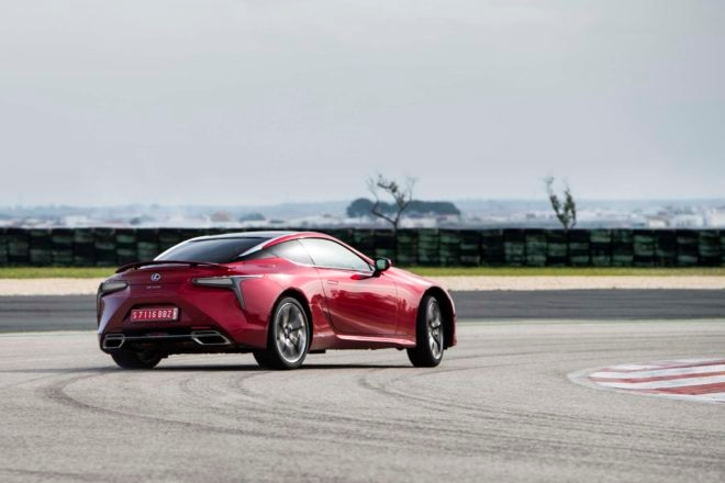 2018 Lexus LC 500h rear three quarter in motion
