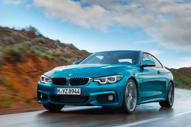 2017 BMW 440i M Sport coupe front three quarter in motion 05