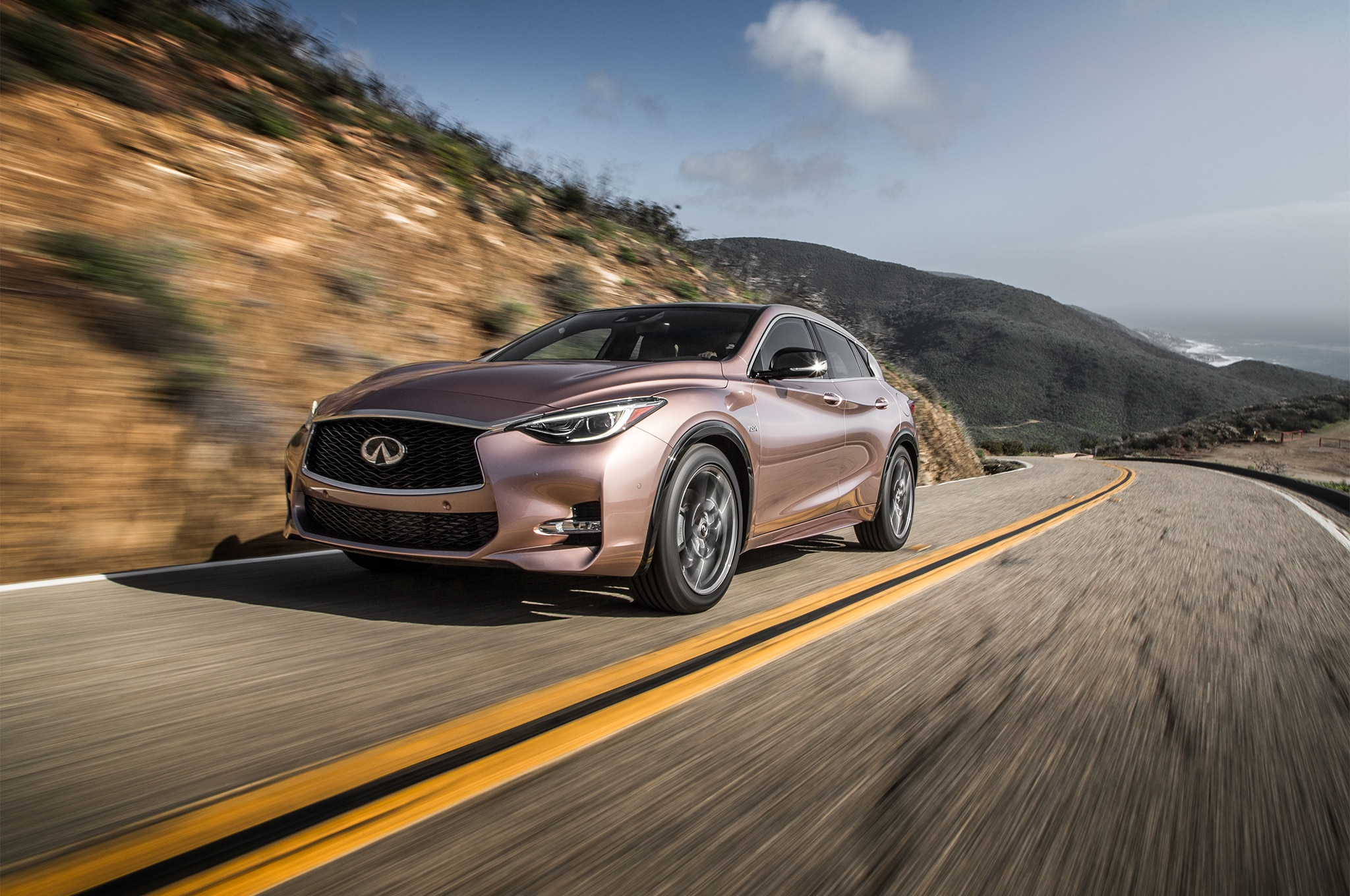 2017 Infiniti QX30 Sport Front Three Quarter In Motion 02