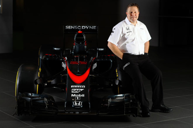 McLaren Technology Group Executive Director Zak Brown With Formula 1 Car