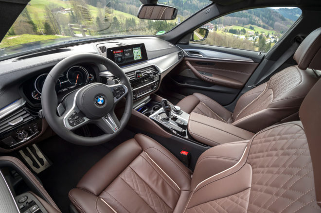 2018 BMW M550i xDrive interior from driver door