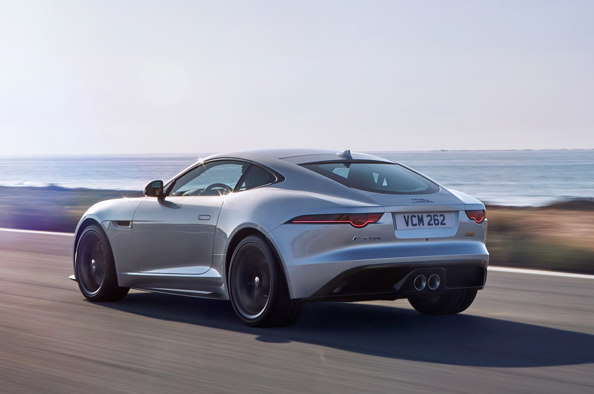 2018 Jaguar F Type 400 Sport Rear Three Quarter In Motion 02 1