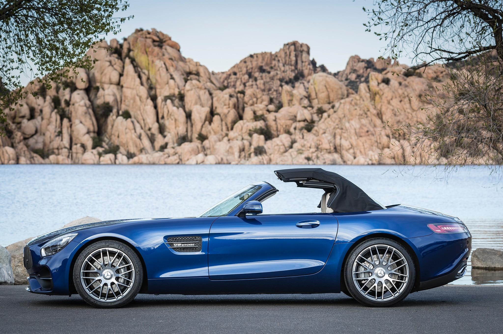 https://st.automobilemag.com/uploads/sites/11/2017/04/2018-Mercedes-AMG-GT-Roadster-side-top-up.jpg