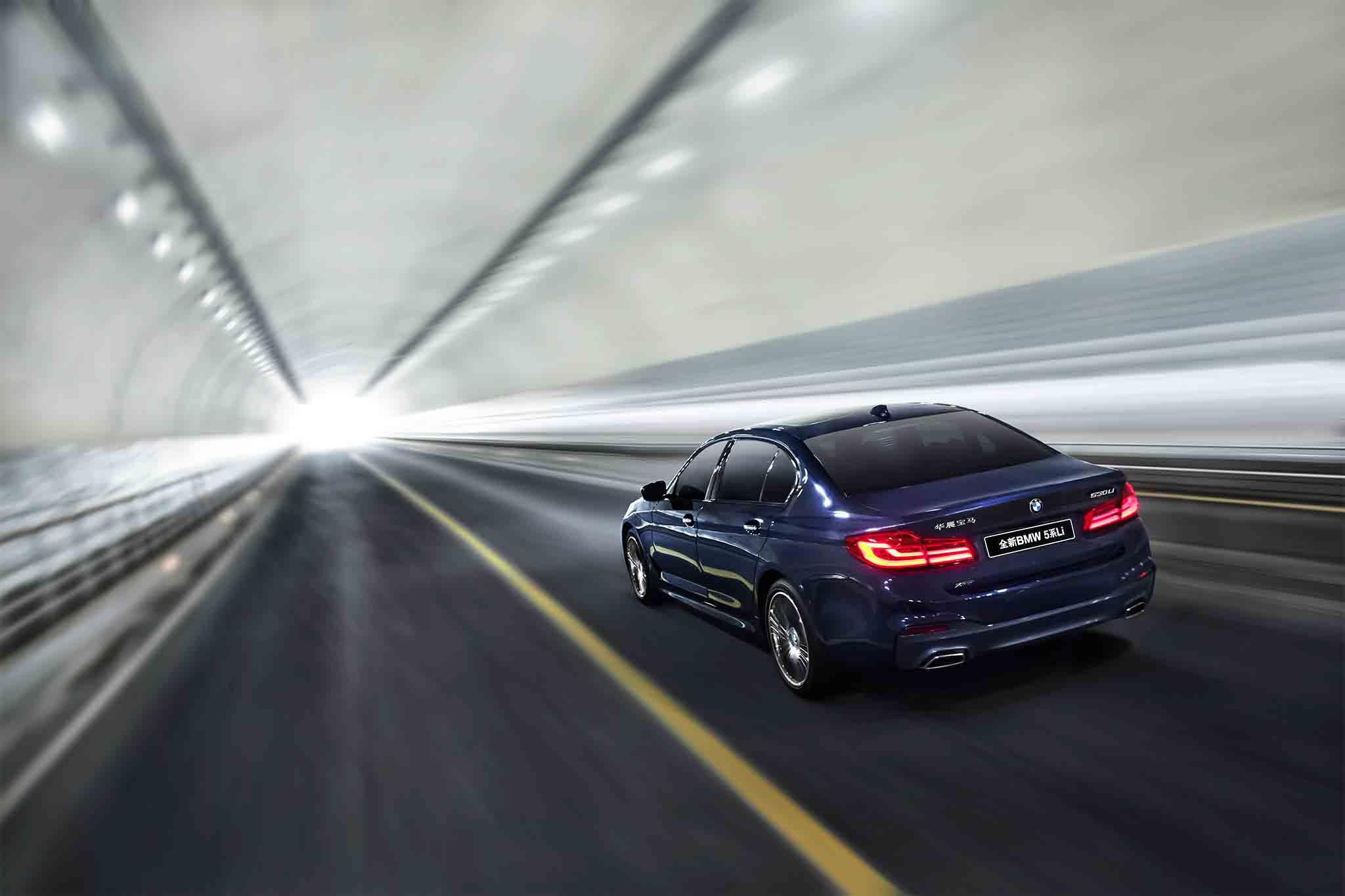 Chinese-market-BMW-5-Series-long-wheelbase-rear-three-quarter-in-motion-1