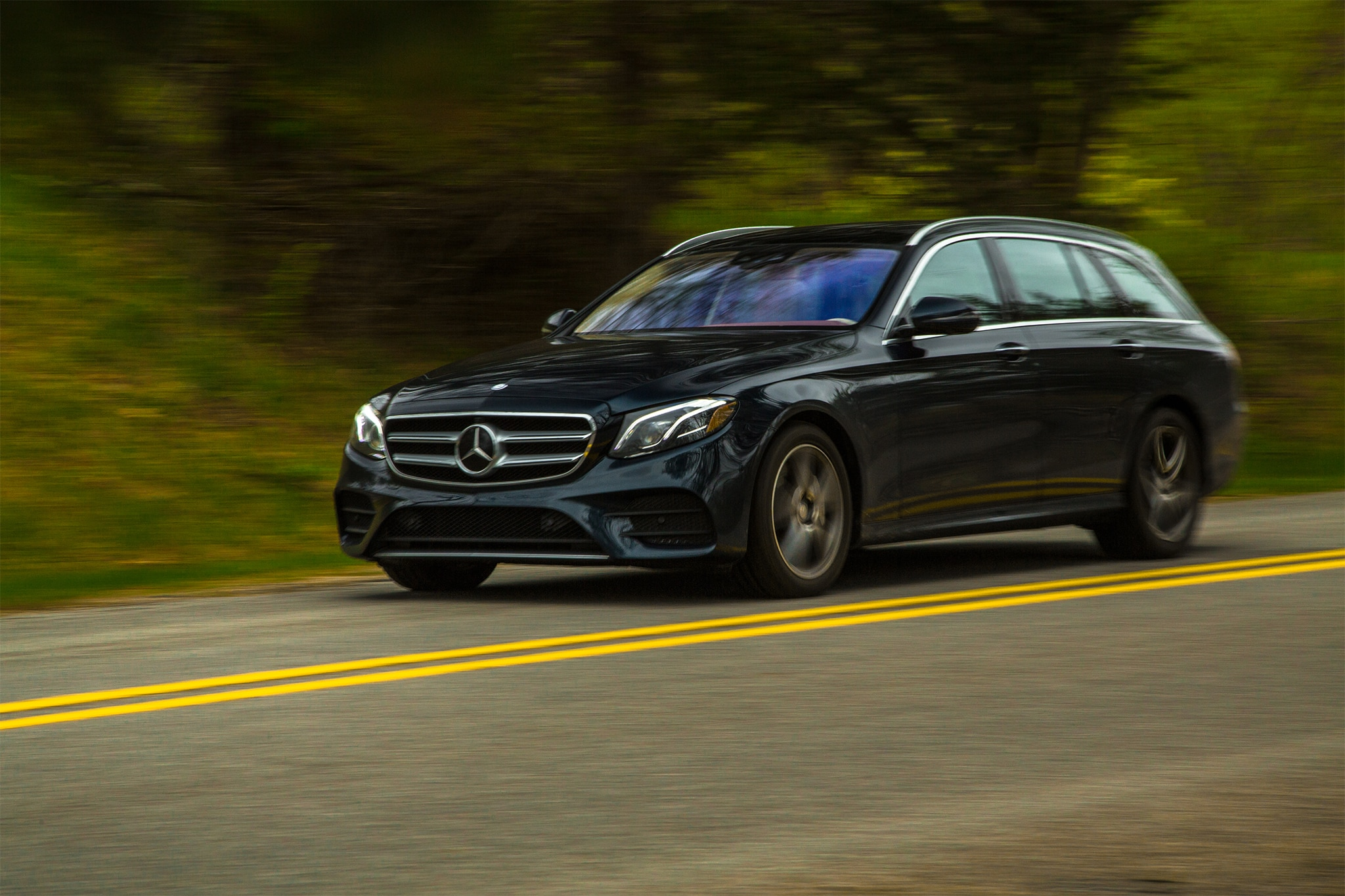 2017 Mercedes Benz E400 4Matic Wagon Front Three Quarter In Motion 02