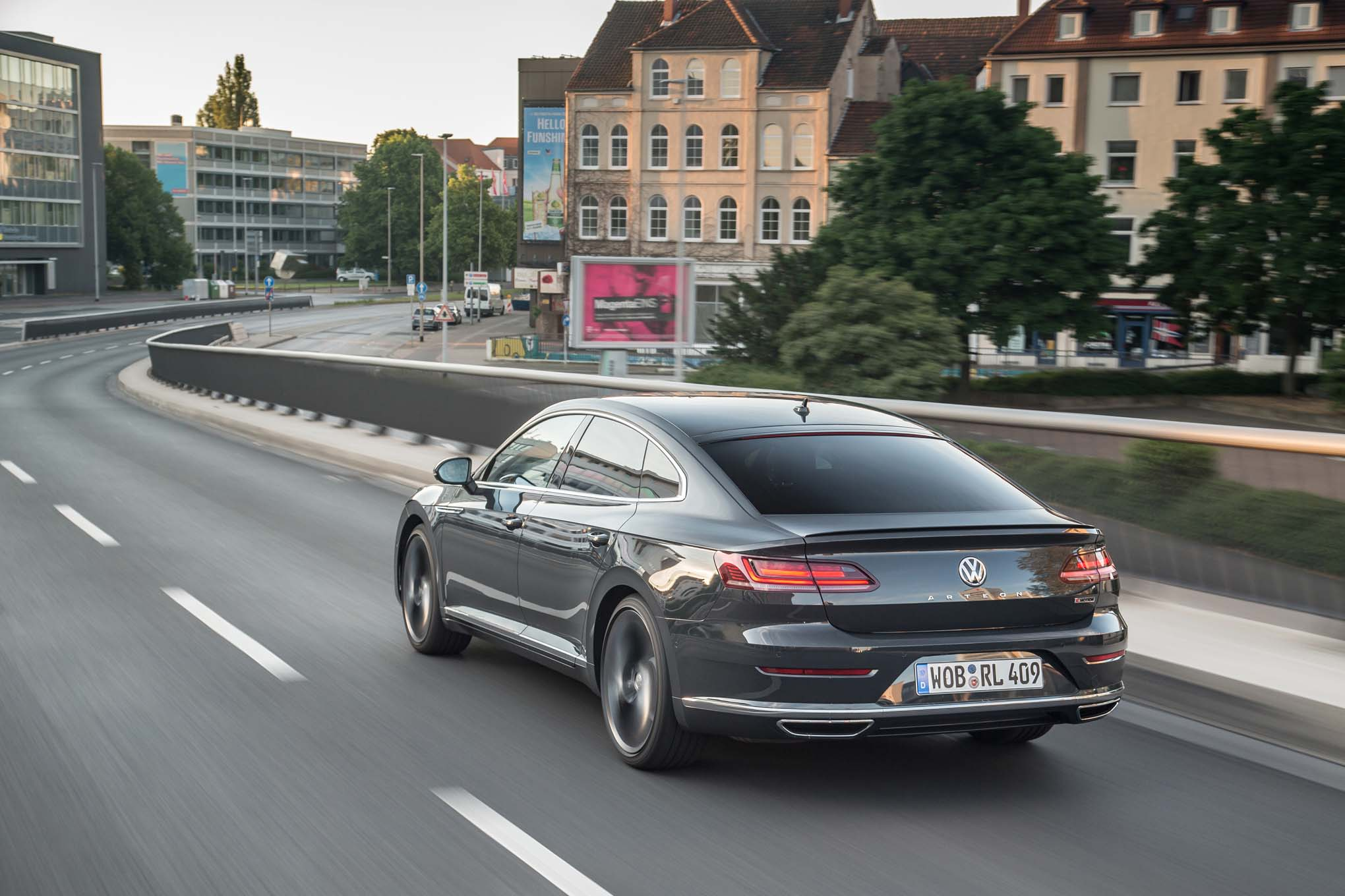 2019 Volkswagen Arteon R Line Rear Three Quarter In Motion 03 1