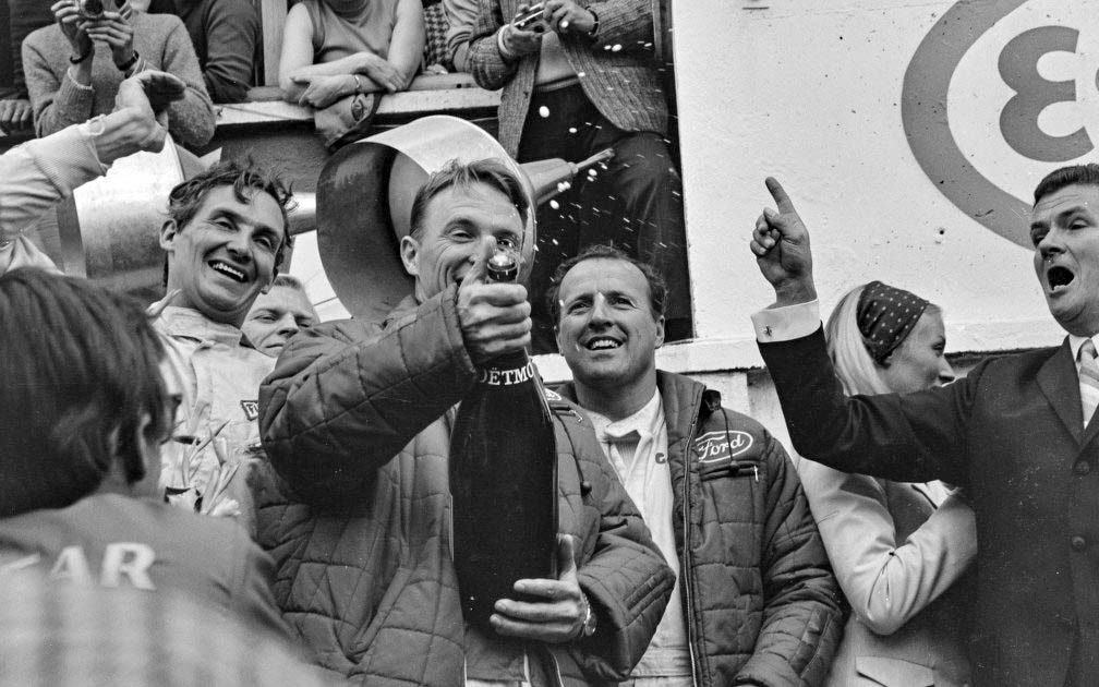Dan Gurney Popping Champagne 1967