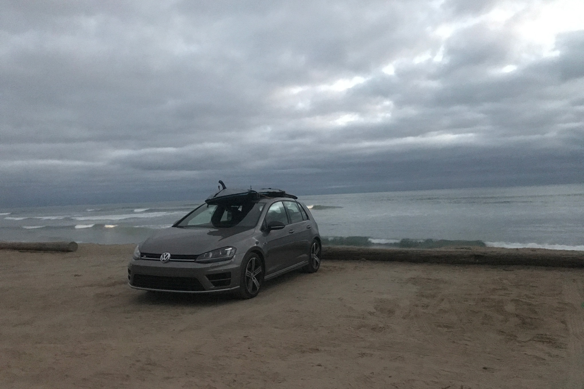 Four Seasons 2016 Volkswagen Golf R On Beach With Surfboard
