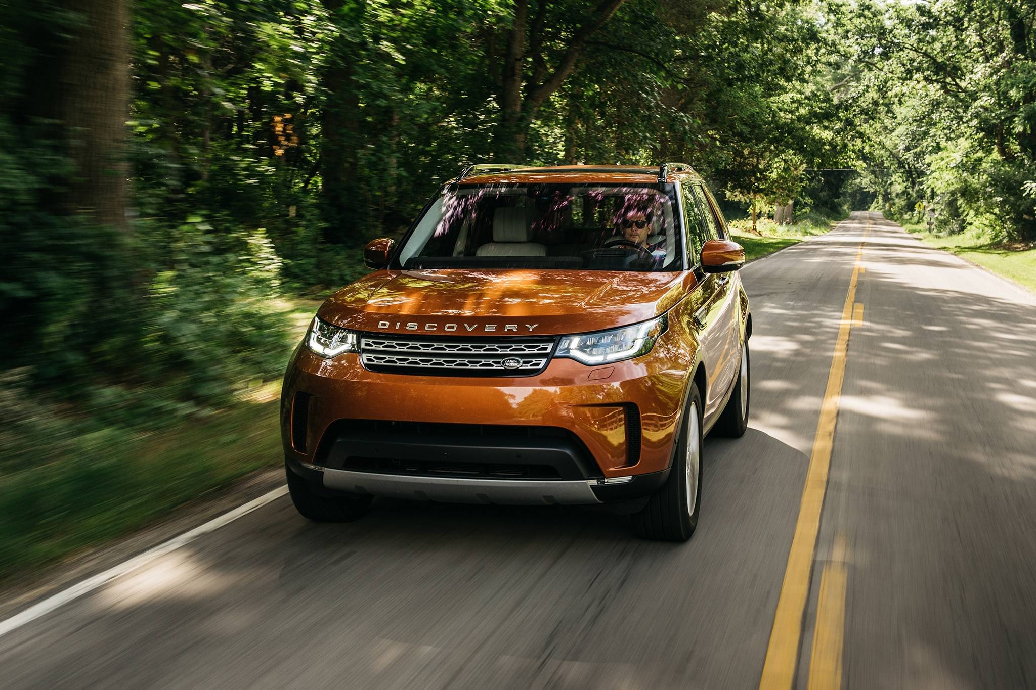 2017 Land Rover Discovery Td6 HSE Rear Three Quarter In Motion 03