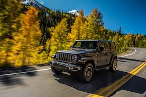2018 Jeep Wrangler Sahara Front Three Quarter In Motion 01