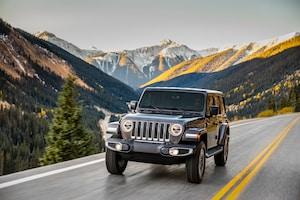 2018 Jeep Wrangler Sahara Front Three Quarter In Motion 02