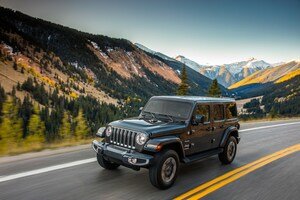 2018 Jeep Wrangler Sahara Front Three Quarter In Motion 03