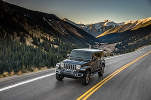 2018 Jeep Wrangler Sahara Front Three Quarter In Motion 04