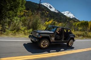 2018 Jeep Wrangler Sahara Front Three Quarter In Motion 08