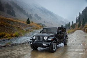 2018 Jeep Wrangler Sahara Front Three Quarter In Motion 10