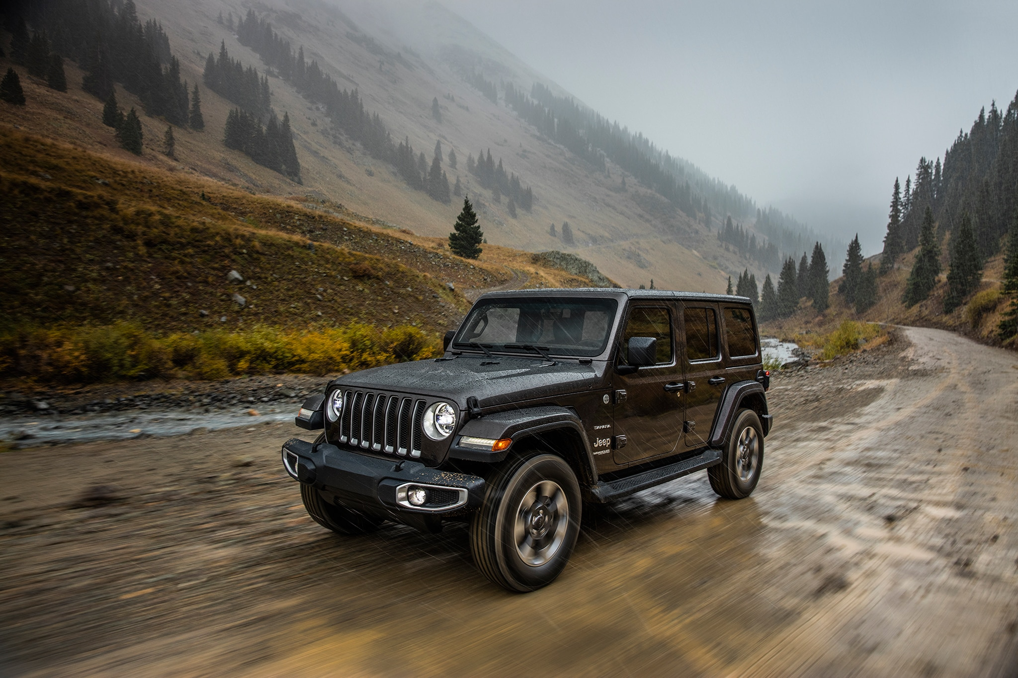 2018 Jeep Wrangler Sahara Front Three Quarter In Motion 11