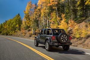 2018 Jeep Wrangler Sahara Rear Three Quarter In Motion 02