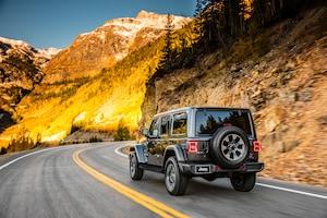 2018 Jeep Wrangler Sahara Rear Three Quarter In Motion 03