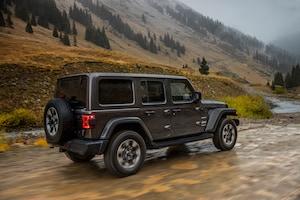 2018 Jeep Wrangler Sahara Rear Three Quarter In Motion 04