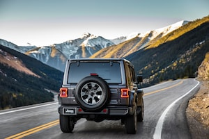 2018 Jeep Wrangler Sahara Rear View In Motion 03