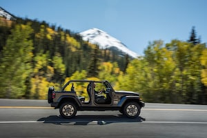 2018 Jeep Wrangler Sahara Side Profile In Motion 01