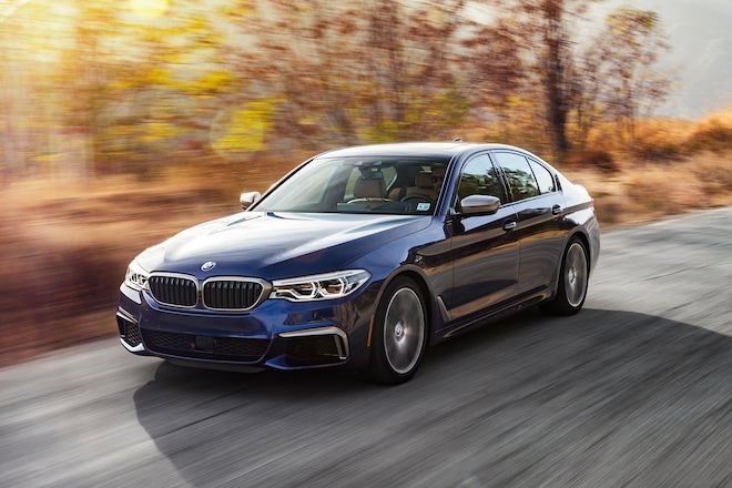 2018 BMW M550i Front Three Quarter In Motion 01