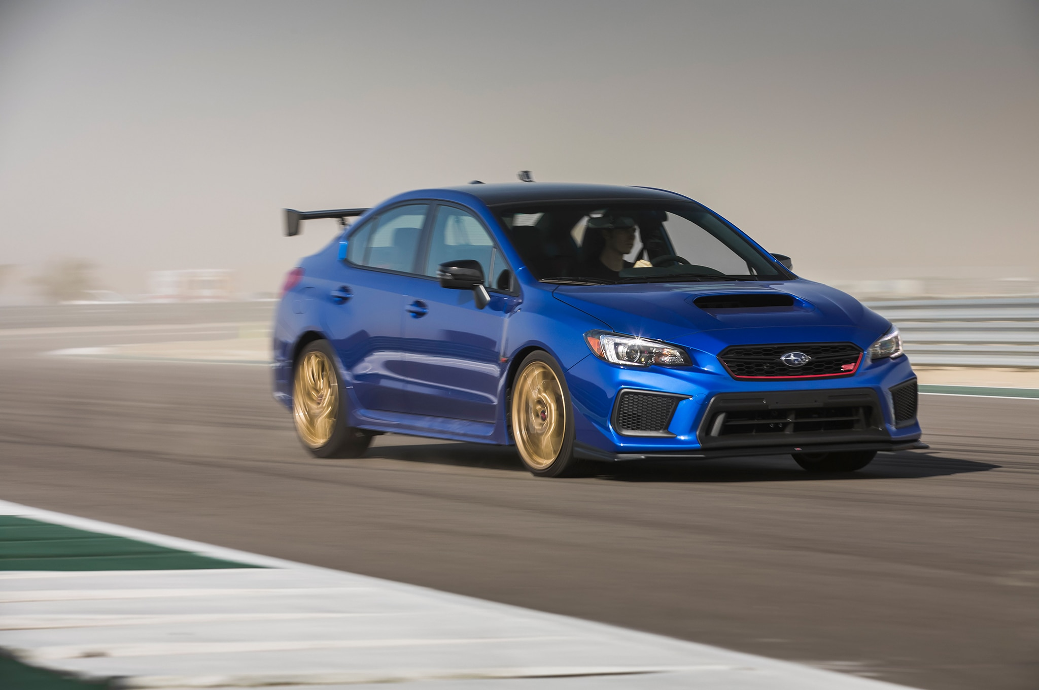 2018 Subaru WRX STI Type RA Front Three Quarter In Motion 38