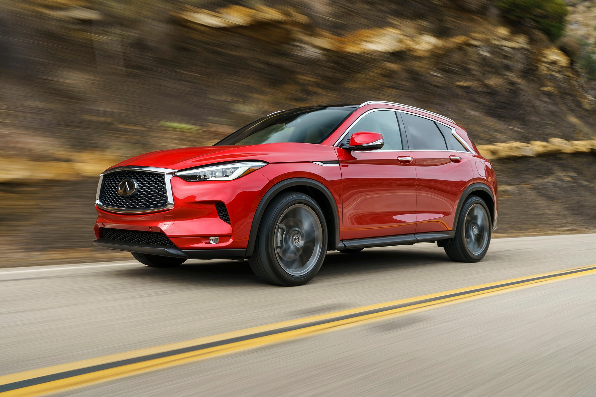 2019 Infiniti QX50 Front Three Quarter In Motion 09