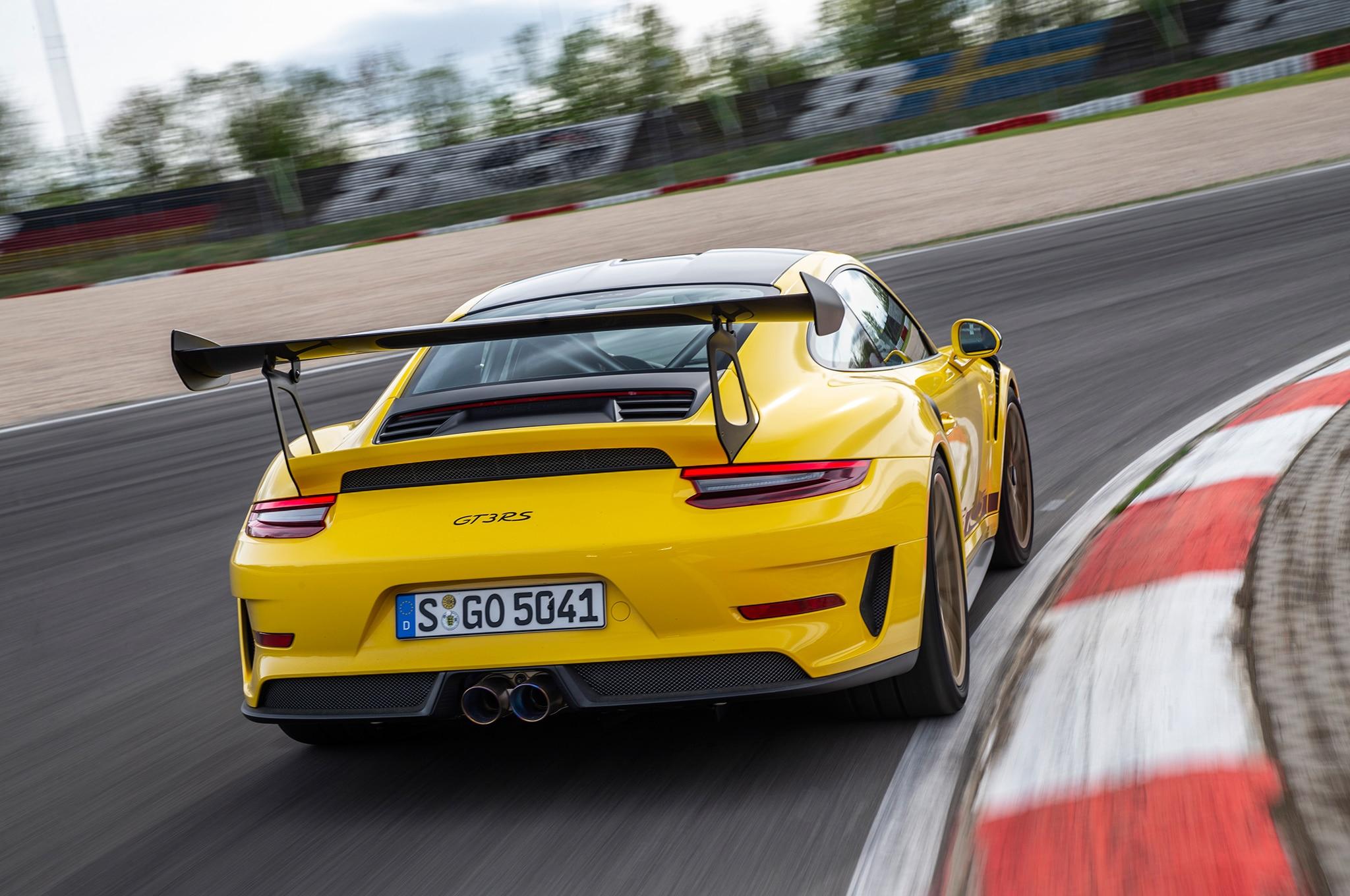2019 Porsche 911 GT3 RS Weissach Package Rear Three Quarter In Motion 06