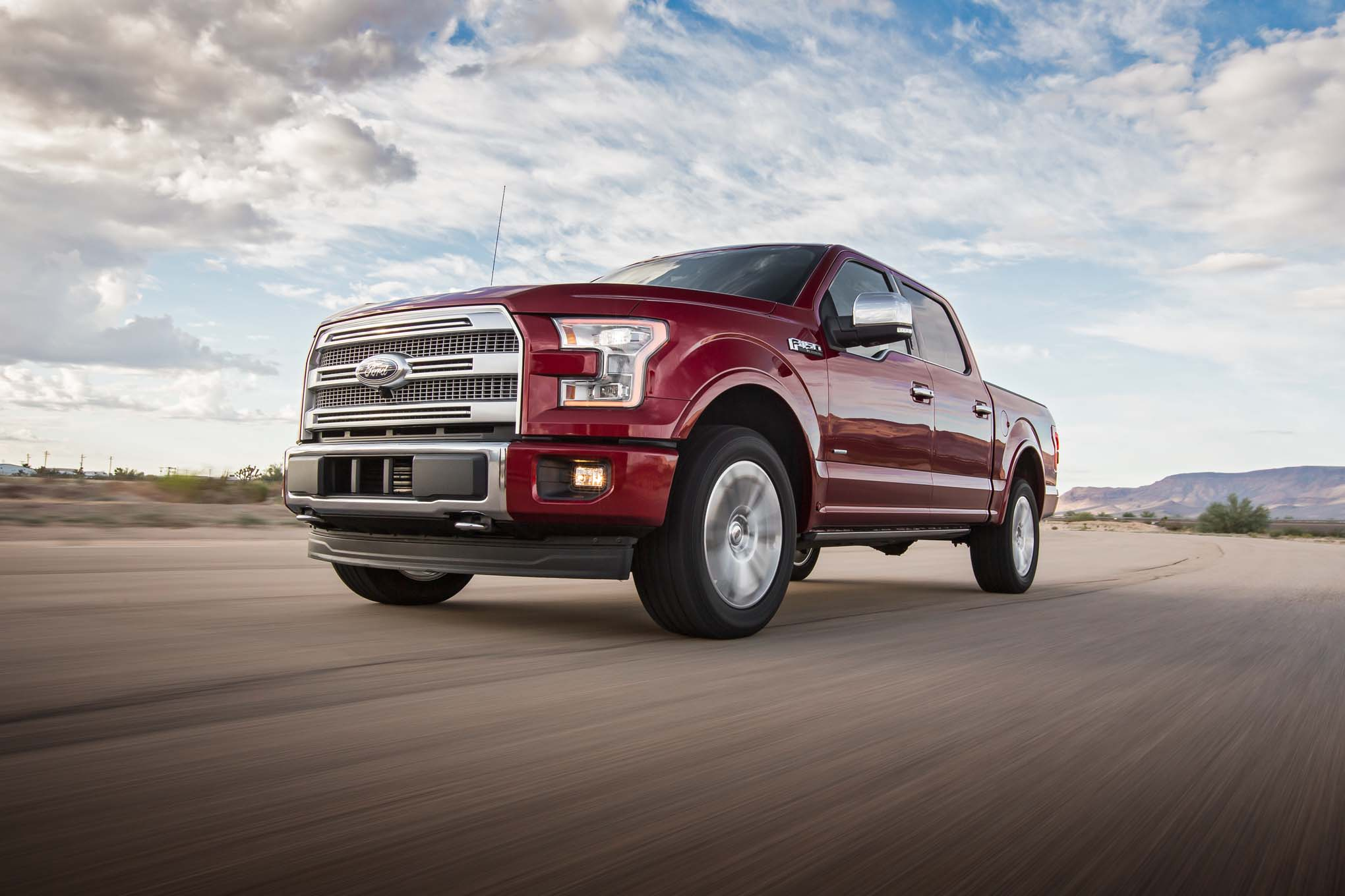2017 Ford F 150 Platinum 4x4 EcoBoost Front Three Quarter In Motion 04