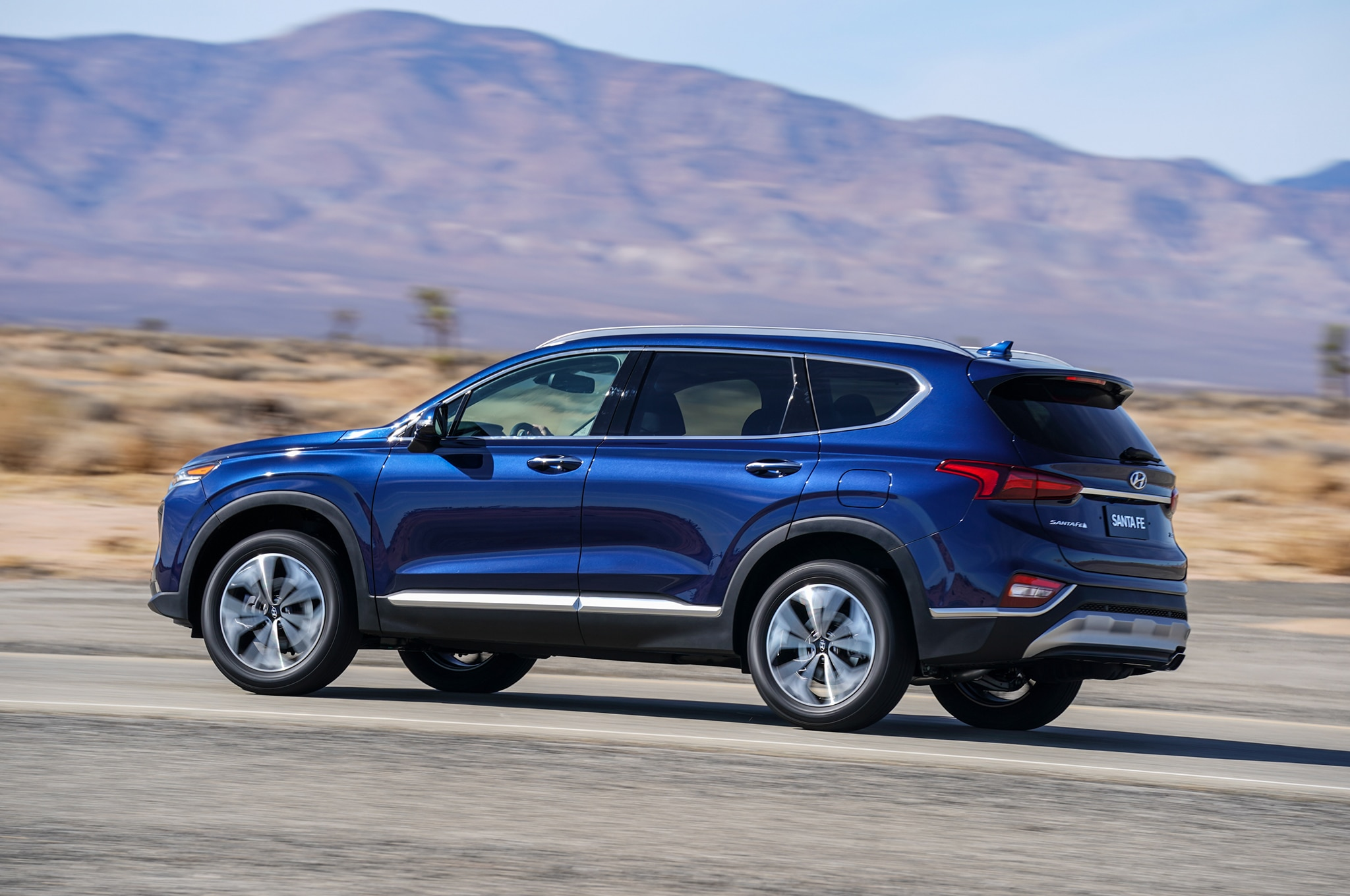 2019 Hyundai Santa Fe Rear Three Quarter In Motion 01
