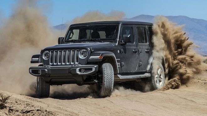 2018 Jeep Wrangler Unlimited Sahara 4x4 Front Three Quarter In Motion 1