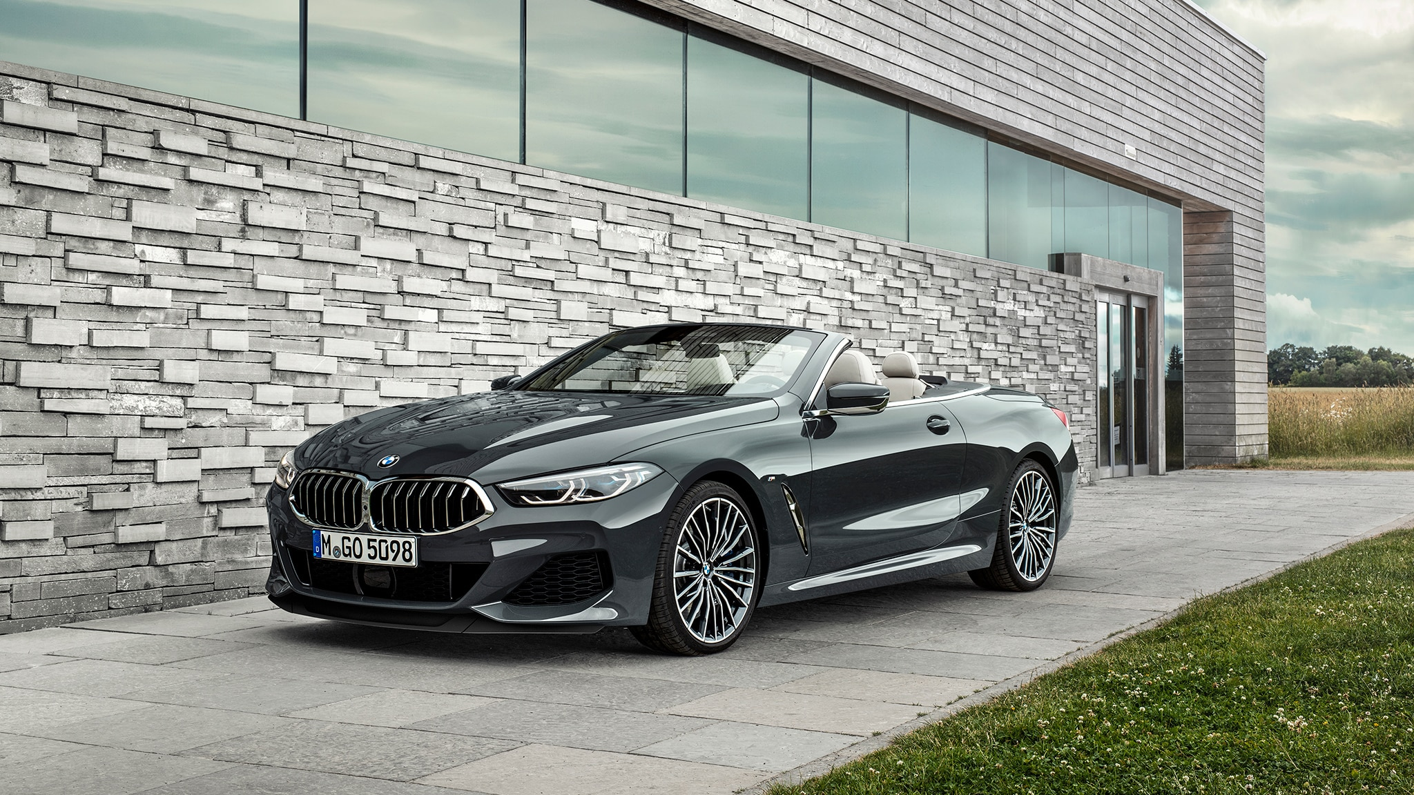2019 BMW M850i Convertible Parked Near Modern Building