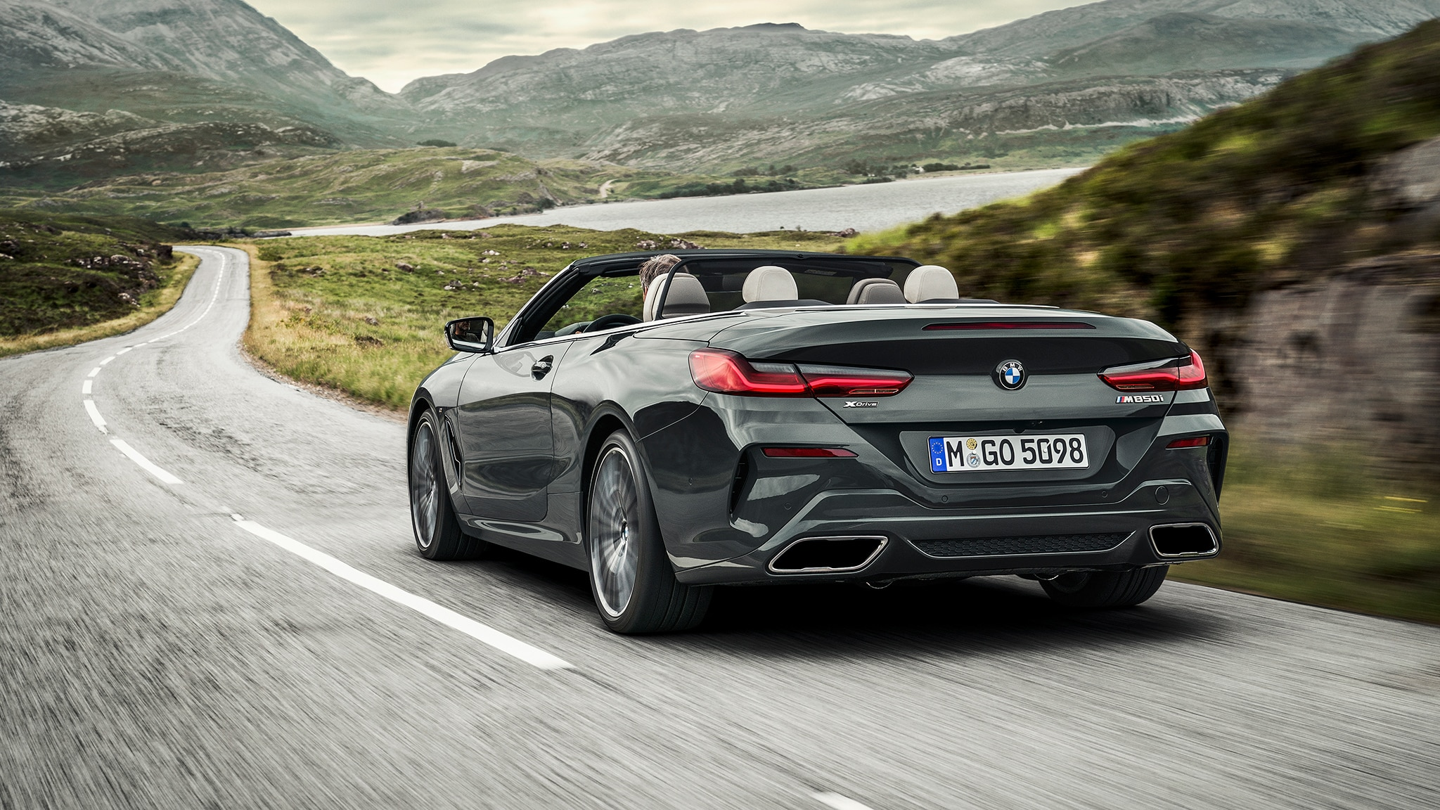 2019 BMW M850i Convertible Rear Side Motion View Road Ahead