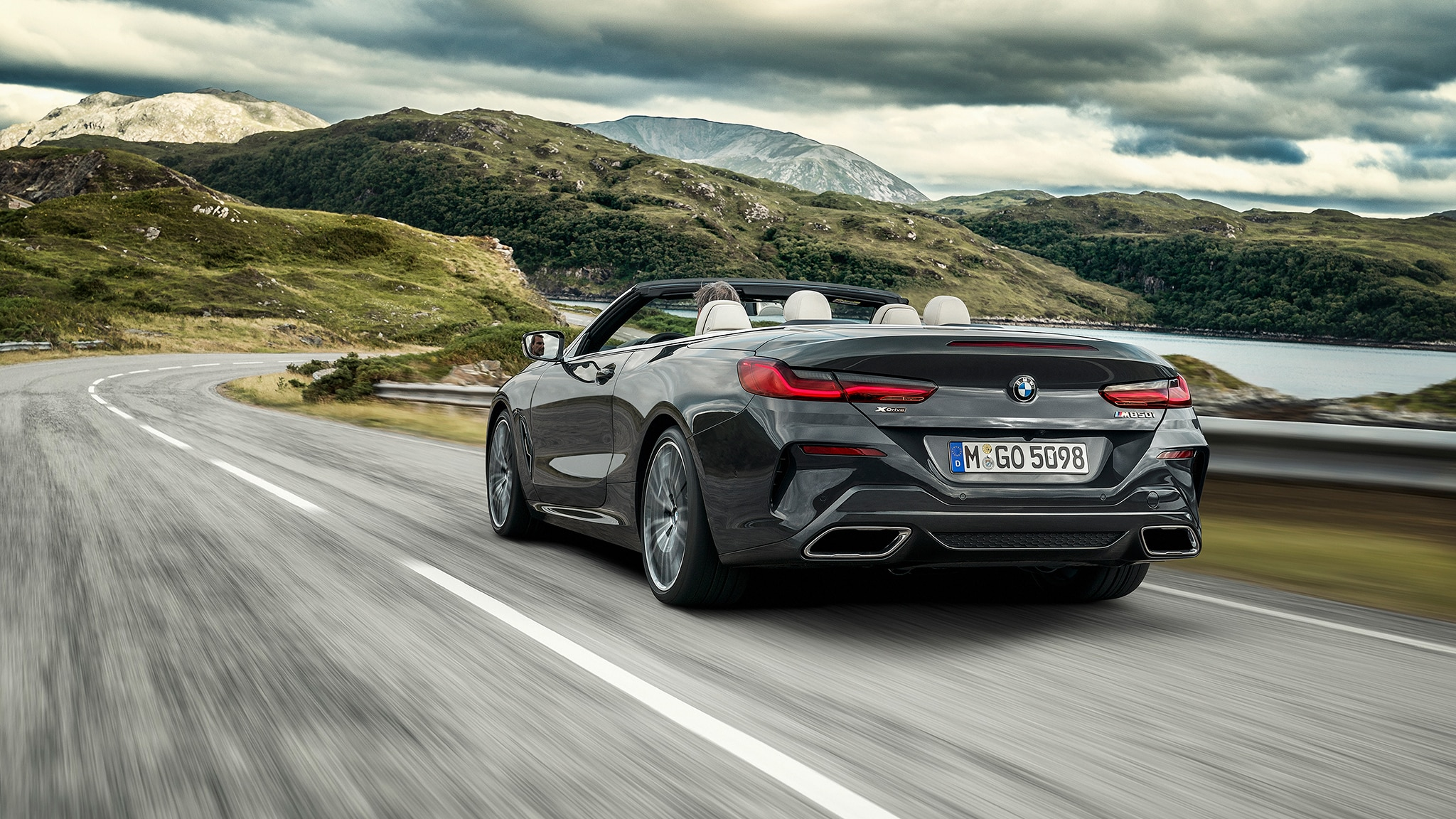 2019 BMW M850i Convertible Rear Side View Approaching Curve