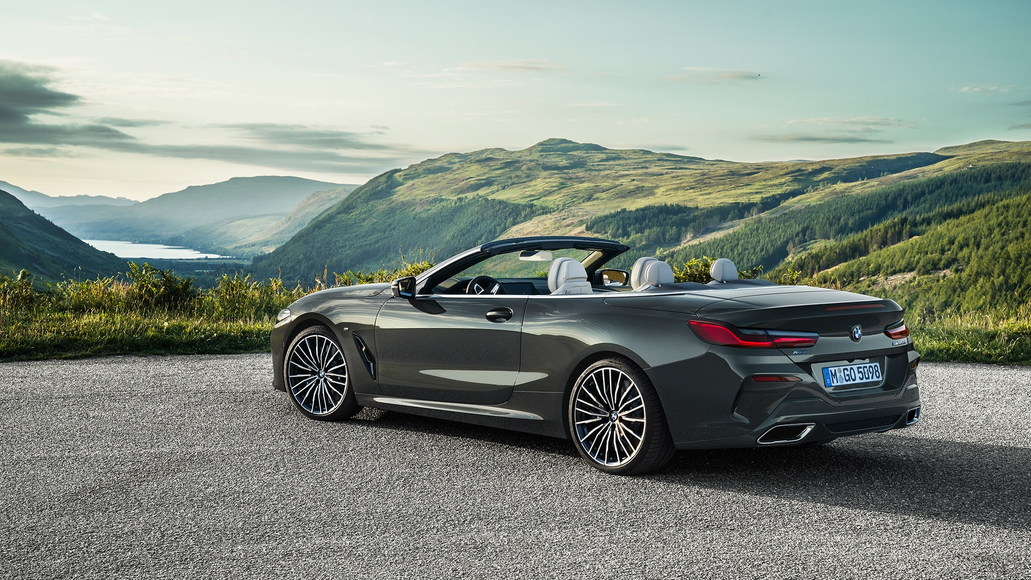 2019 BMW M850i Convertible Rear Side View With Mountains