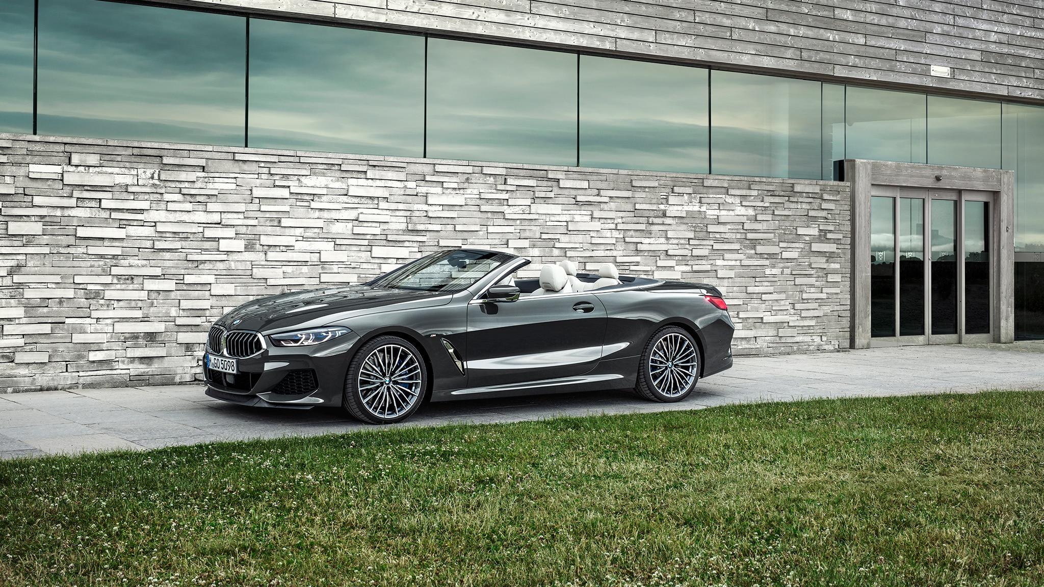 2019 BMW M850i Convertible Side Front View With Building