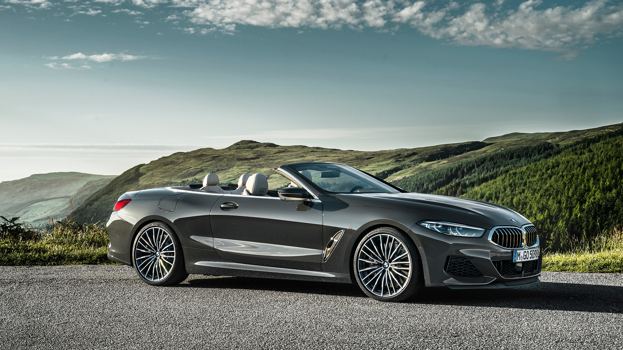 2019 BMW M850i Convertible Side Front View With Clouds